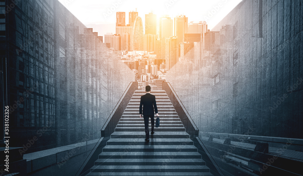 Fototapeta Ambitious business man climbing stairs to meet incoming challenge and business opportunity. The high stair represents the concept of career path success, future planning and business competitions.