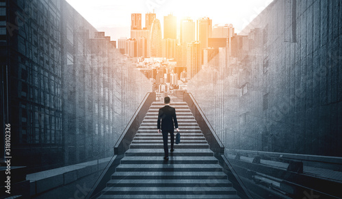 Fototapeta Ambitious business man climbing stairs to meet incoming challenge and business opportunity