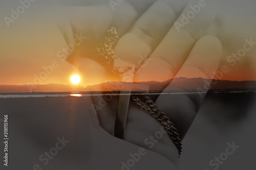 Beautiful Sunrise With Catholic Golden Cross In Palm Of Hand Wallpaper Mural