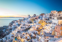 High Angle View Of Townscape By Sea Against Sky During Sunset