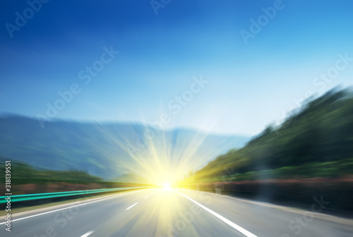 car on the road with motion blur background Canvas Print