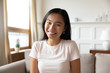 Headshot of millennial Asian woman have video call