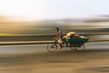 Vendor Riding Pedicab On Road