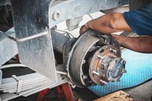 Technicians Remove The Wheels ...