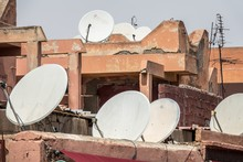 Closeup Shot Of White Satellite Dishes Put On The Roofs Of Buildings