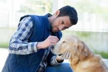 Male Vet Cleaning Dogs Ears