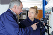 Leinwanddruck Bild - aviation technician pointing at telephone inside aircraft