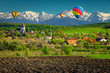 Rural landscape with Hosman village and hot air balloons, Romania