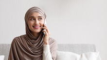 Young Muslim Woman In Headscar...