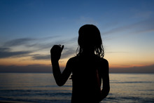 Silhouette Girl With Crab At B...