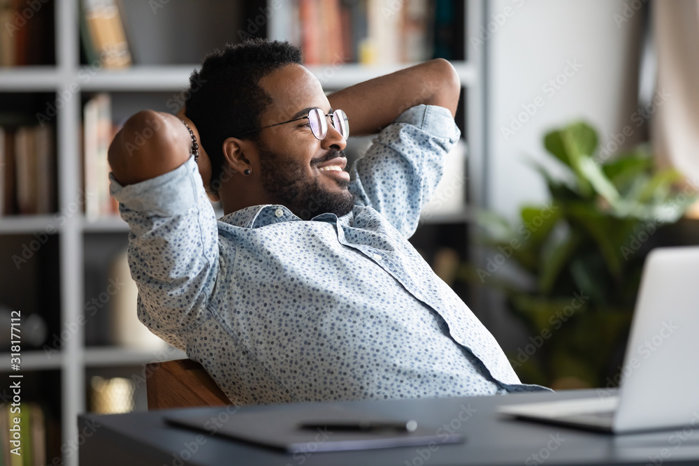 Fototapeta Relaxed calm african businessman resting sit at office desk