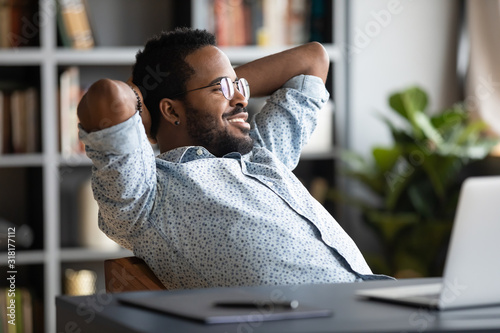 Cuadros en Lienzo Relaxed calm african businessman resting sit at office desk