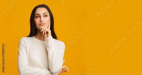 Fotografie, Tablou Pensive Brunette Girl Touching Her Chin, Thinking About Something