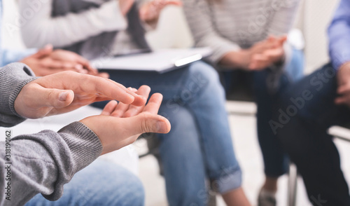 Cuadros en Lienzo Closeup of unrecognizable male hands applauding at group therapy session