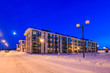 Leinwanddruck Bild - Winter snowy evening Typical architecture of village suburb Moscow region, Russia. Small modern colorful city in winter snowy evening. Four-storey multi-panel apartment house.