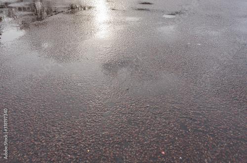 wet asphalt. gray coarse fabric Canvas Print