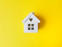 House Models On Yellow Background