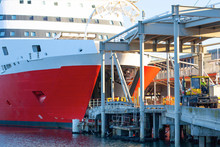 The Bow Of The Large Red Ferry Spirit Of Tasmania With An Open Cargo Lock And Bridge For Loading.