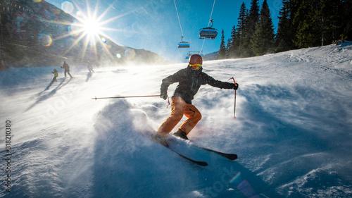 Teenage skier braking during windy conditions Fototapet
