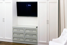 A Television Between Two White...