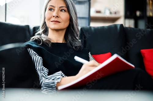 Inspired businesswoman looking away with smile stock photo