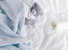 Close-Up Of Teddy Bear In Bed