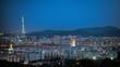 High Angle Shot Of Illuminated Cityscape Against Blue Sky
