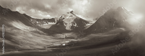 Tablou Canvas Mountain valley, dry and desert high mountains, sepia landscape