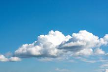 Luminous Clouds Set Against A Dark Blue Sky In The Sun. Wonderful Blue Glowing Cloud