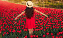 Young Woman Standing On Red Tu...