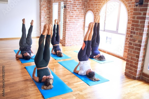 Fotografie, Tablou Young beautiful group of sportswomen practicing yoga
