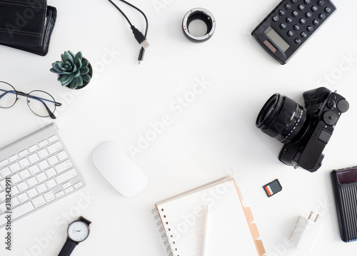 Photo top view of photographer work station, work space concept with digital camera, m