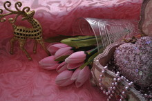 Card With A Golden Antelope Flowers And A Box With Beads On A Pink Background