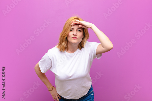 middle age woman looking bewildered and astonished, with hand over forehead look Wallpaper Mural