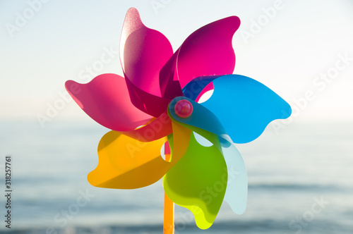 Colorful plastic toys. Windmill. Colorful background Canvas Print