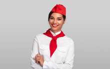 Positive Flight Attendant Smiling For Camera