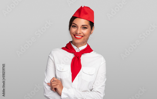 Positive flight attendant smiling for camera Canvas Print