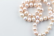 Pink Pearl Necklace Isolated On White Background - Top View Photo Of Beautiful Real Pink Pearls