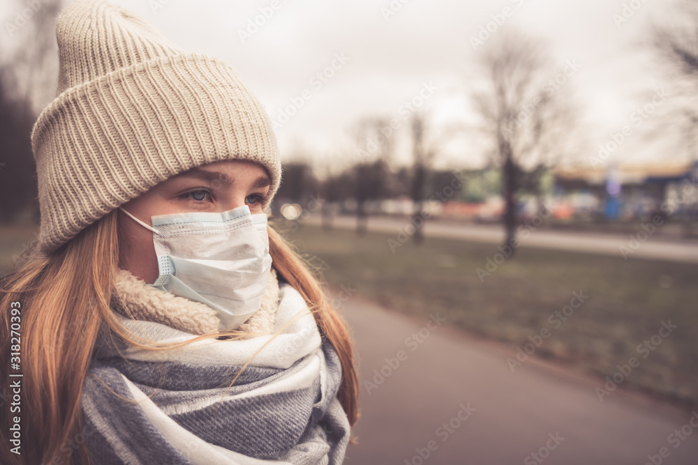 Fototapeta MERS-CoV Chinese infection Corona Virus masked girl on the background of the city in smog, the concept of the epidemic of the virus in China