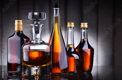 Fototapety, obrazy: Bottles of assorted alcoholic beverages.