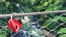 High Angle View Of Red Heart Shape Love Lock On Bridge Over River