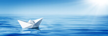 Small White Paper Boat In Big ...