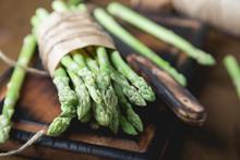 Fresh Asparagus On A Wooden Ta...