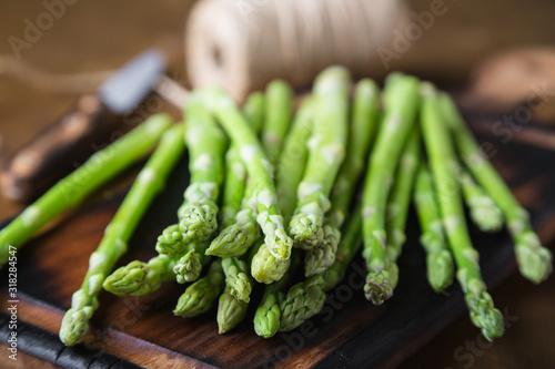 Fresh asparagus on a wooden table Canvas Print