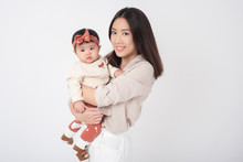 Asian Mother And Adorable Baby...