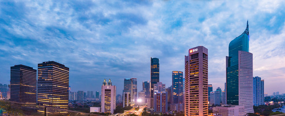 Jakarta, Indonesia - 21 Sept 2018: Aerial view of Jakarta's Central Business District (Sudirman and Kuningan) at a cloudy sunset. Jakarta cityscape at sunset. Panorama/widescreen photo.