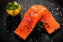 Fresh Raw Salmon Steaks On Bla...