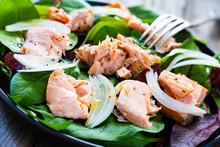 Salmon Salad - Roasted Salmon And Vegetable Leaves On Black Stone Background