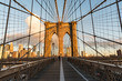 Person Walking On Brooklyn Bridge Walkway At Morning