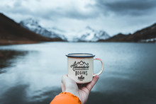 Close-up Of Male Hand Holding Mug. The Adventure Begins Travel,hiking And Camping Concept